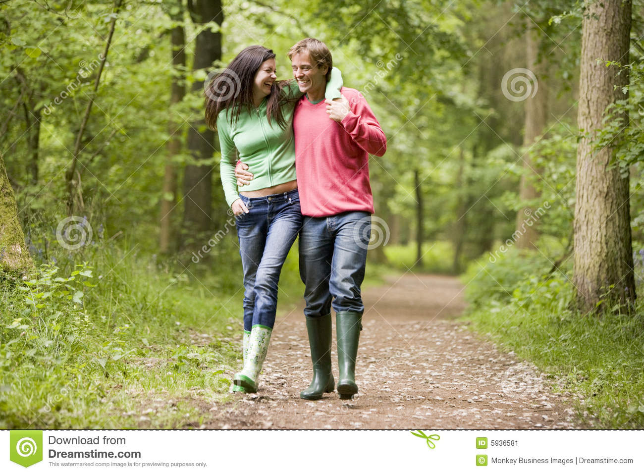 Couple Walking On Path Arm In Arm Stock Image - Image: 5936581