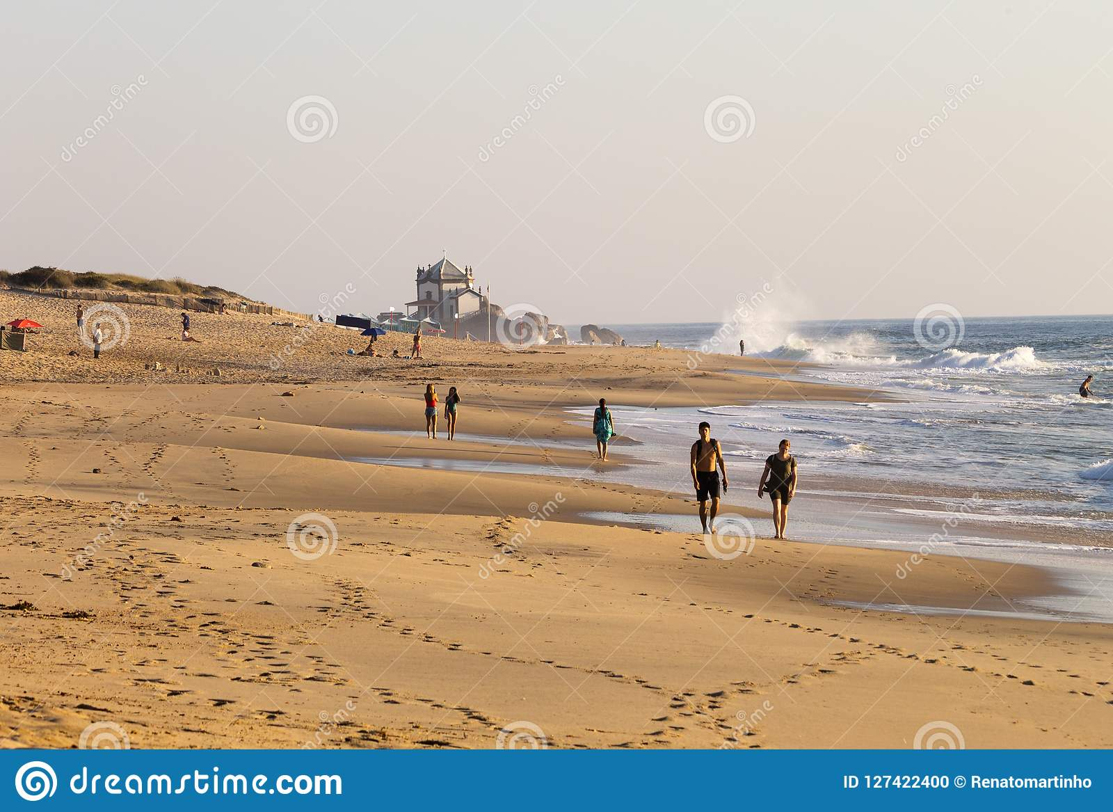 Couple Walks at the Beach