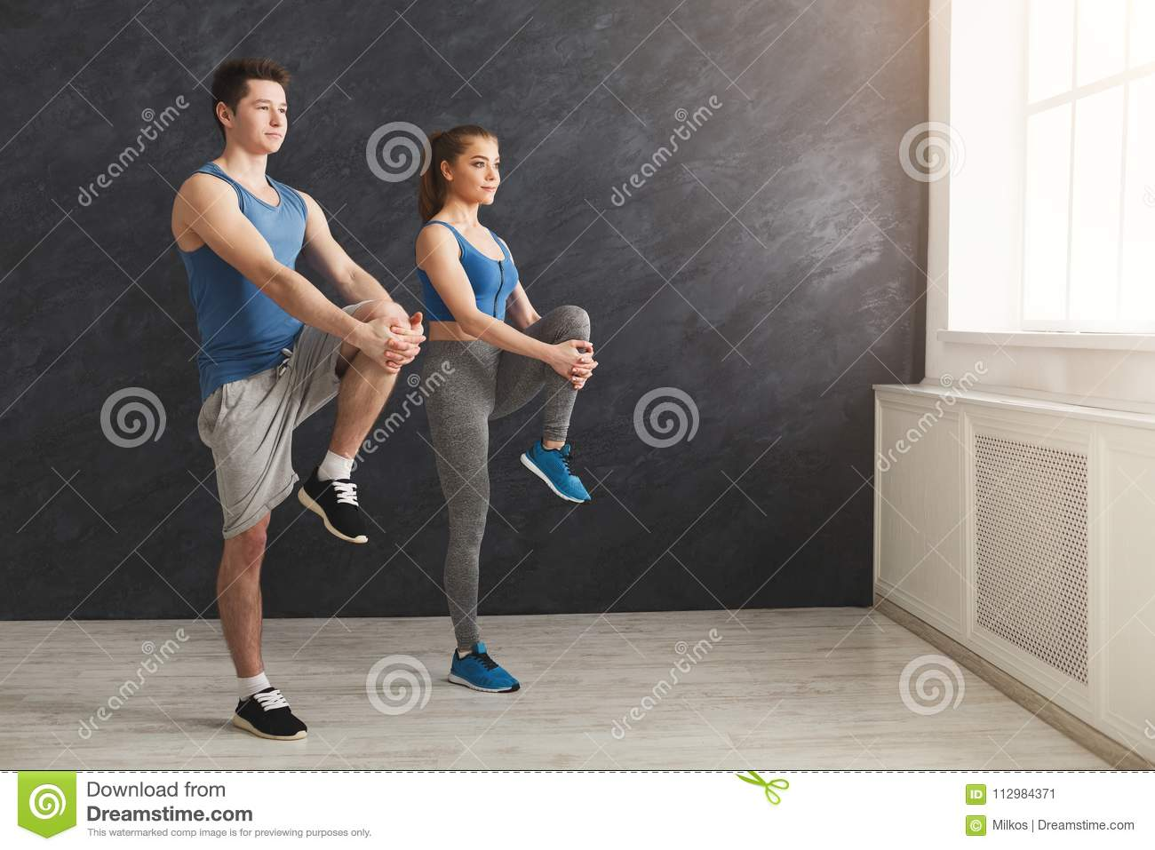 Couple warming up legs before training