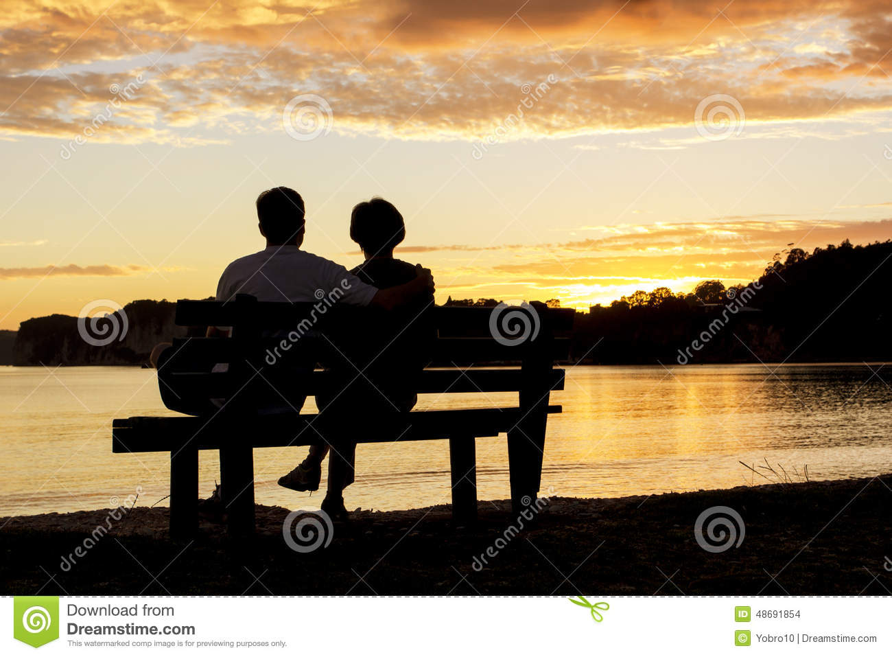Couple Watching A Beautiful Sunset Together Stock Photo ...