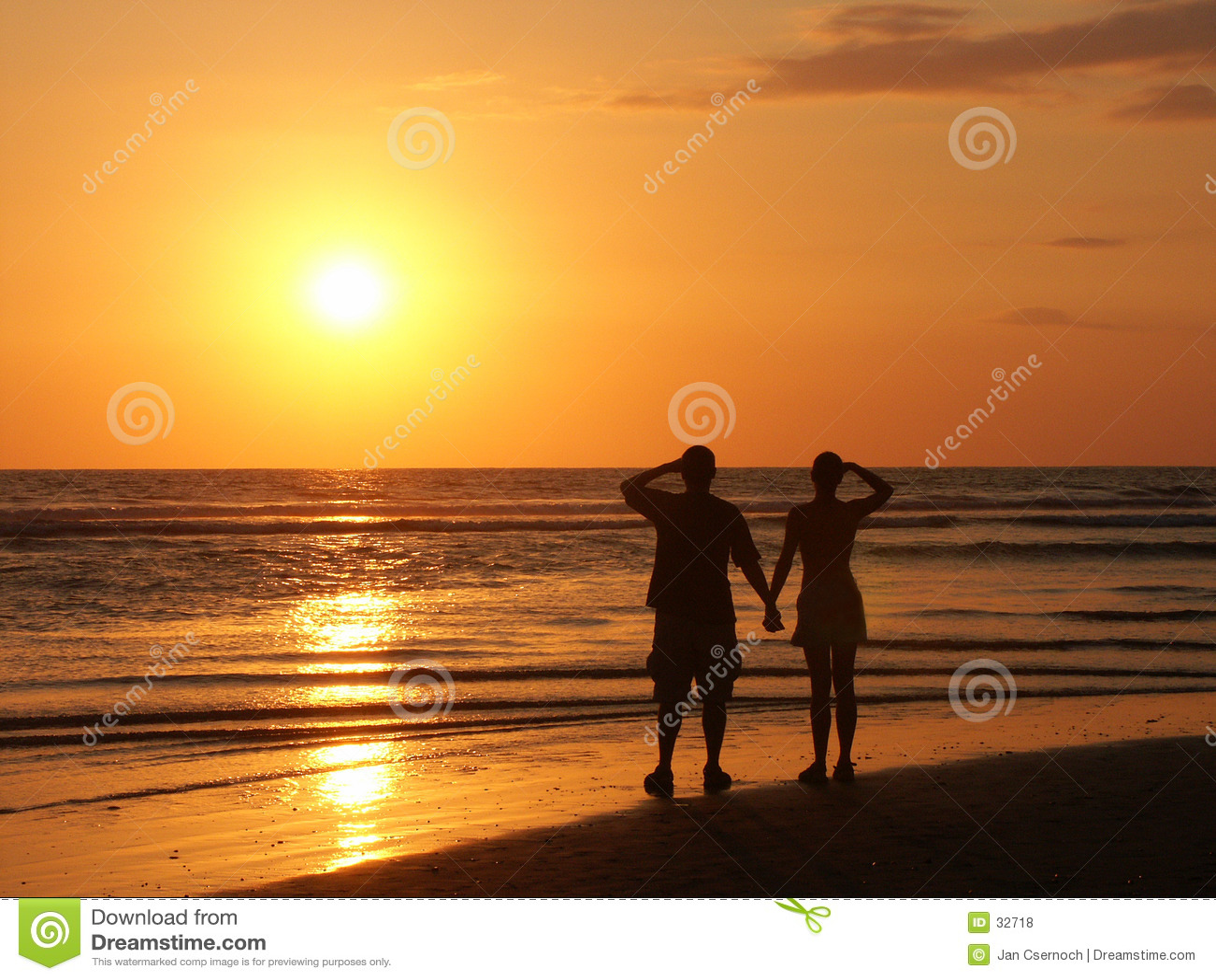 Couple watching the setting sun