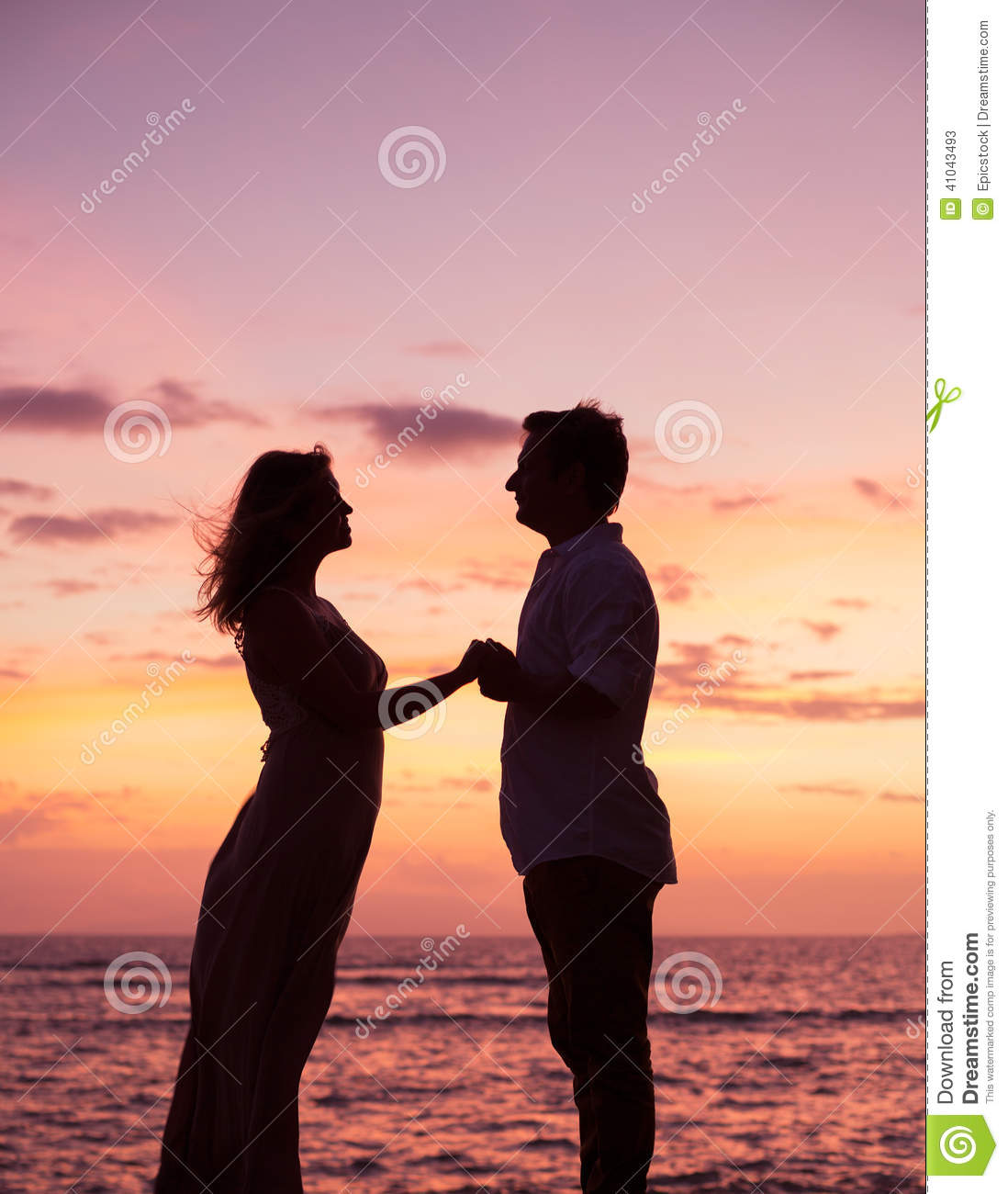 Couple Watching Tropical Sunset Stock Image