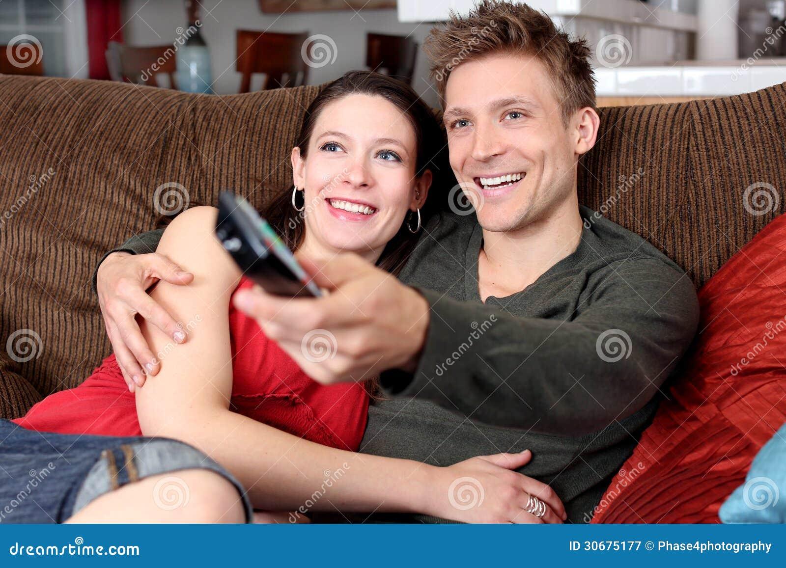 Cuddling Watching Tv Couple watching tvCouple Cuddling Watching Tv