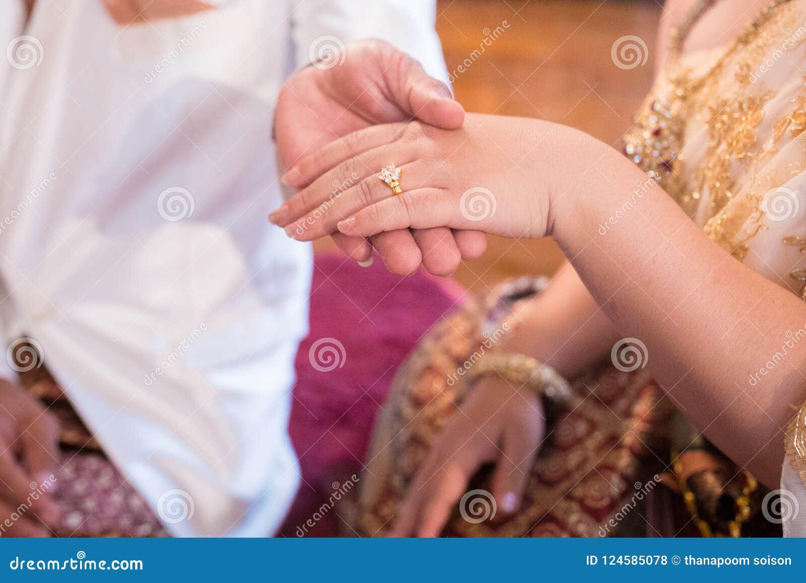 Couple Wear a ring stock photo. Image of beautiful, festive - 124585078