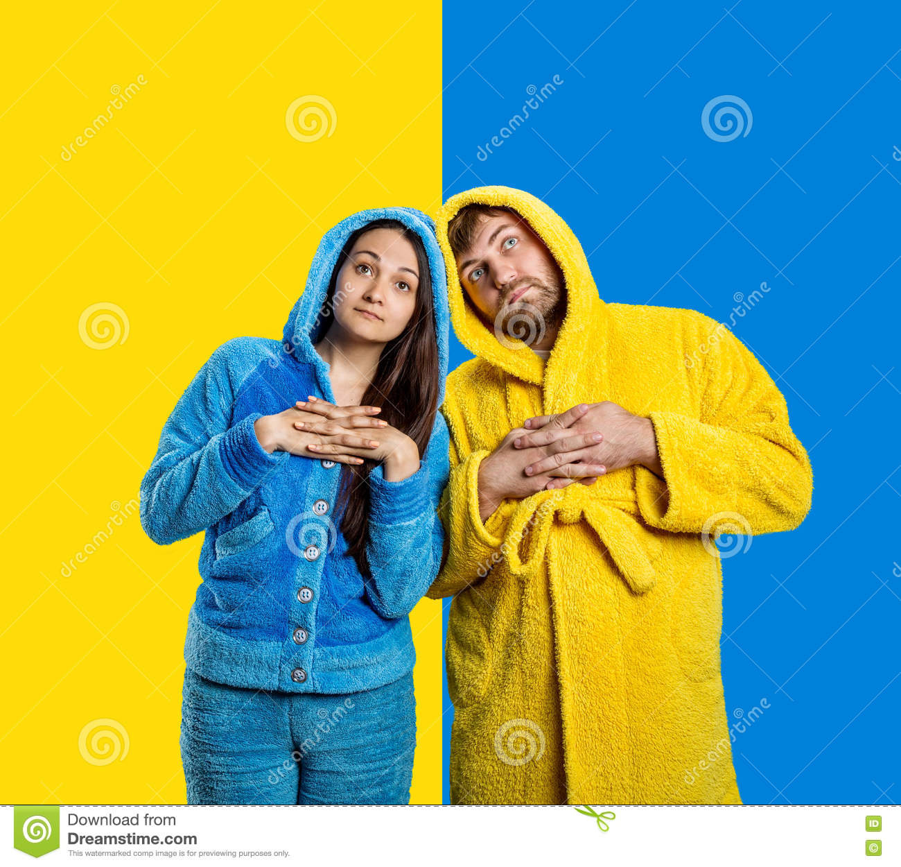Couple Wearing Blue Pijamas And Yellow Bathrobe Stock Photo