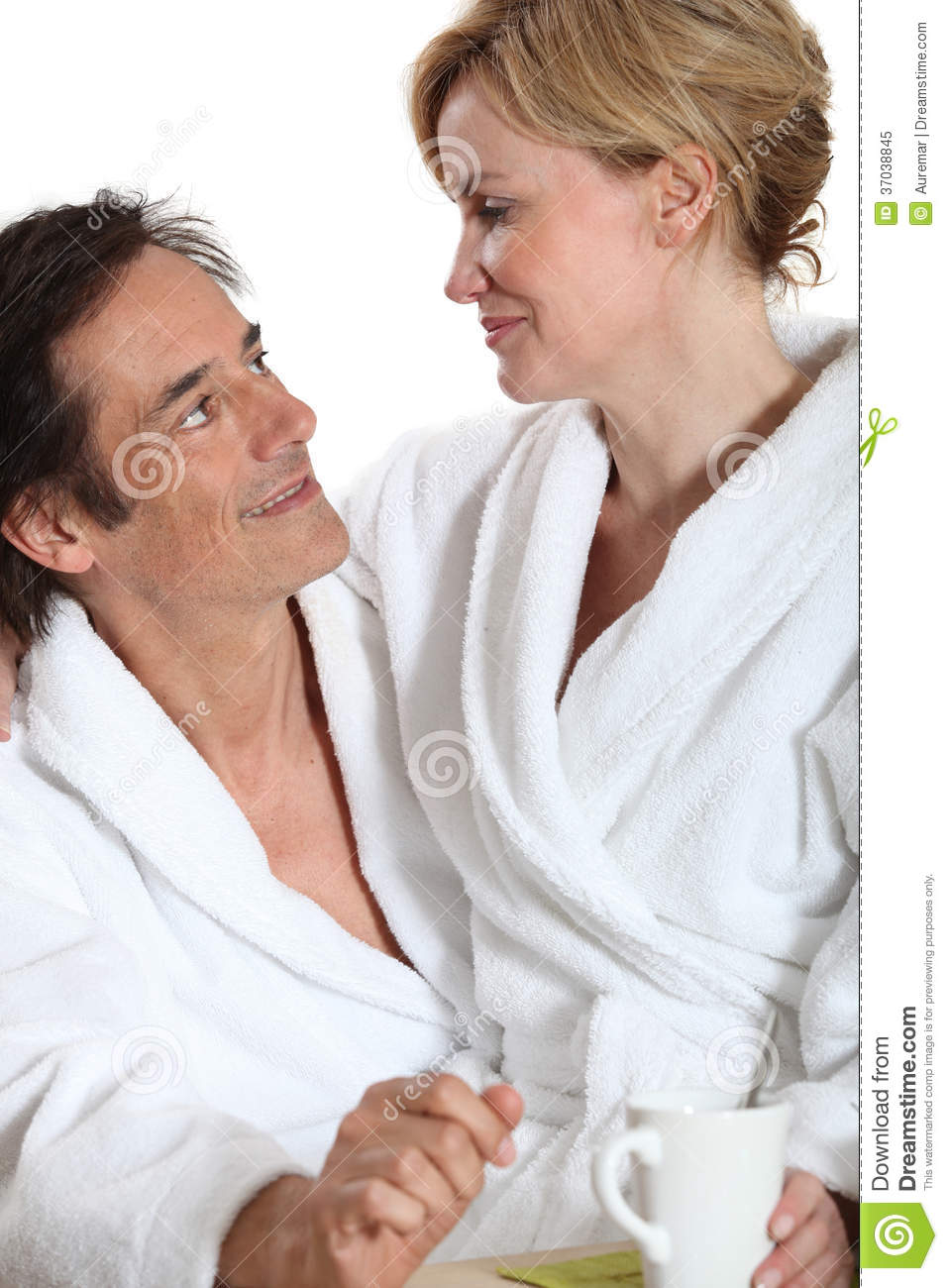 1aa9d81c3e Couple Wearing Dressing Gowns Stock Image - Image of sitting