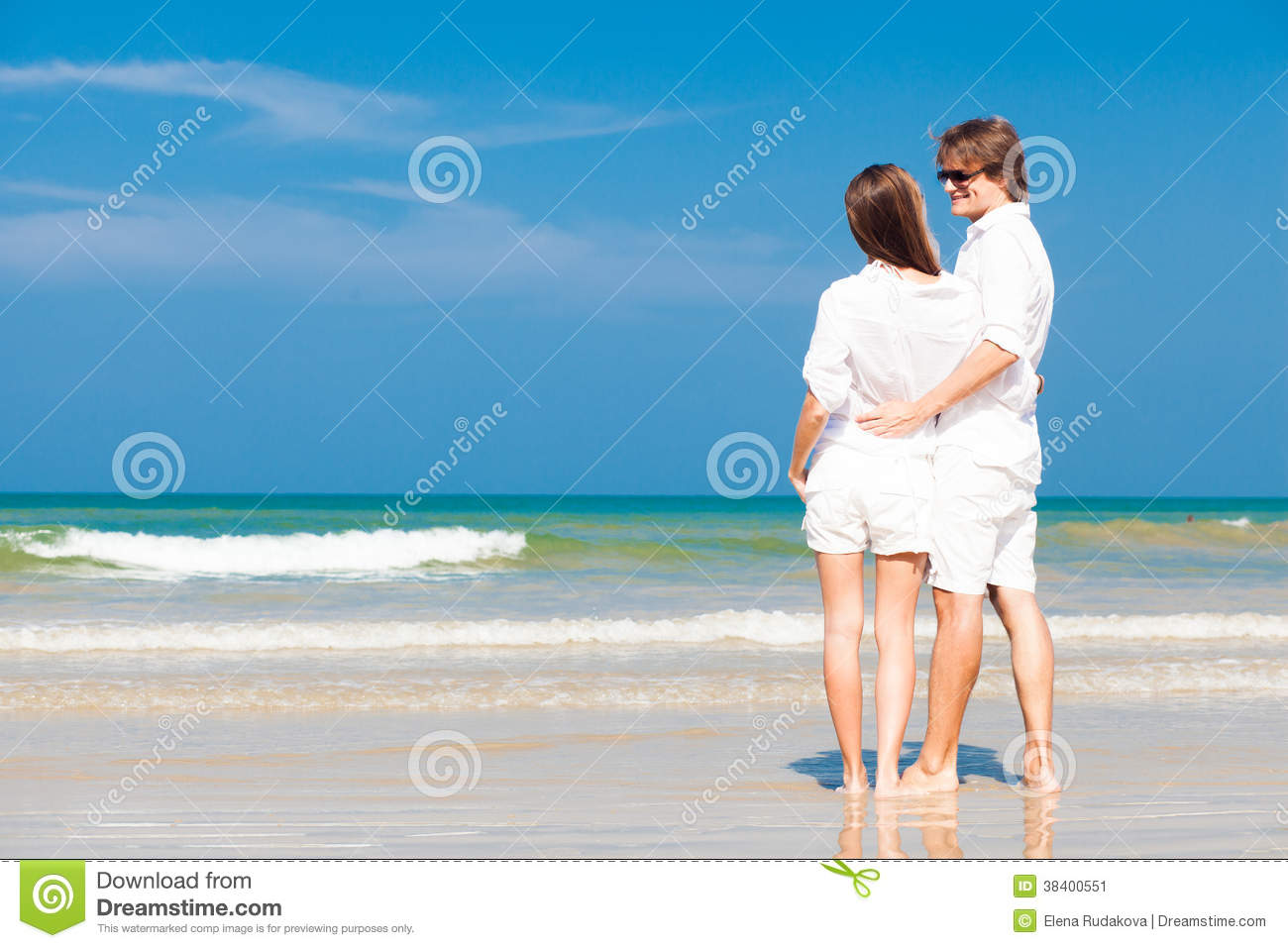Couple in white clothes on tropical beach in stock image for Tropical vacations for couples