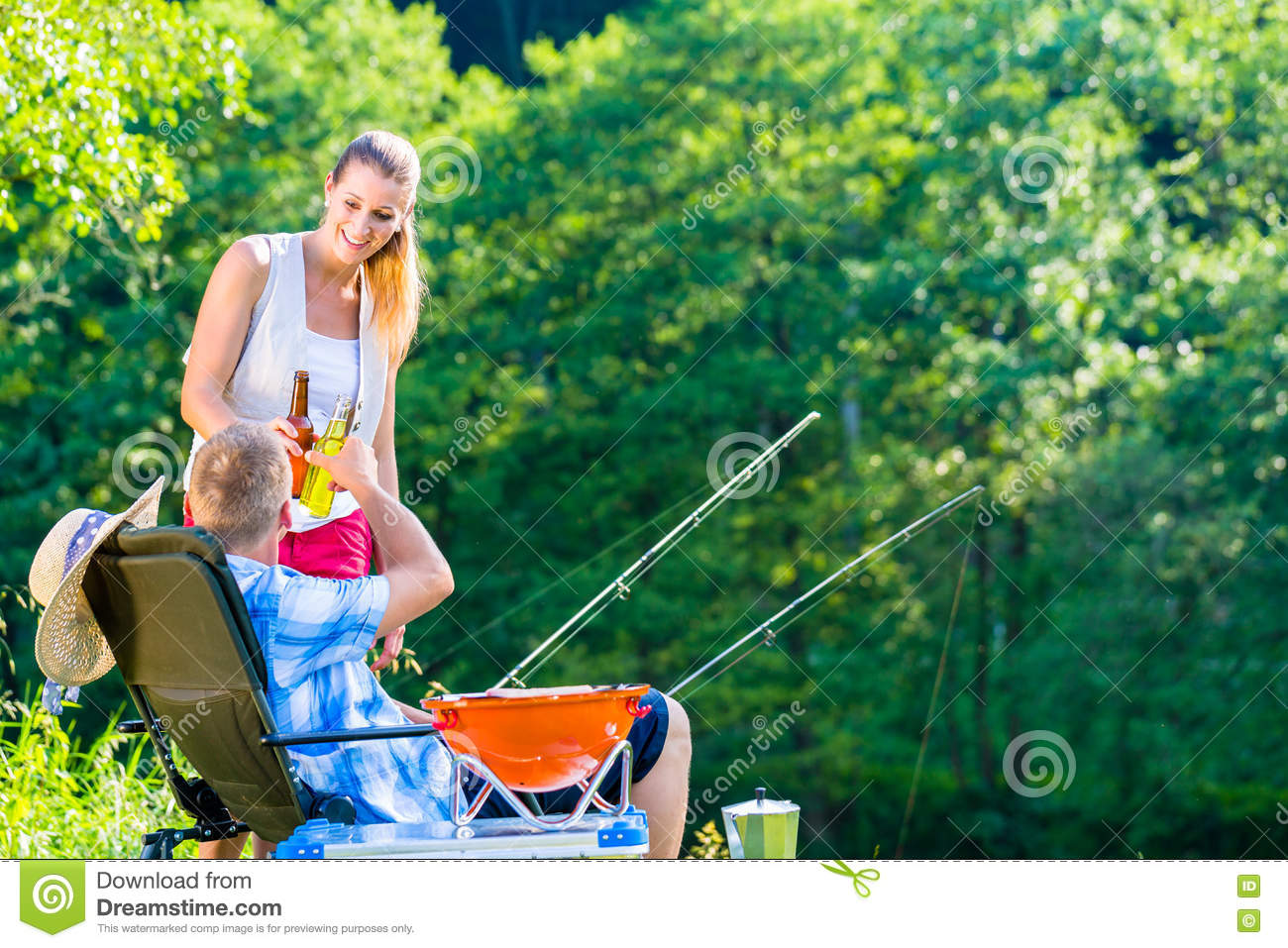 Couple of woman and man having beer while sport fishing