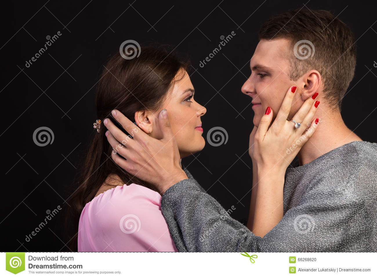 A Couple Of Young Actors On A Dark Background Stock Photo