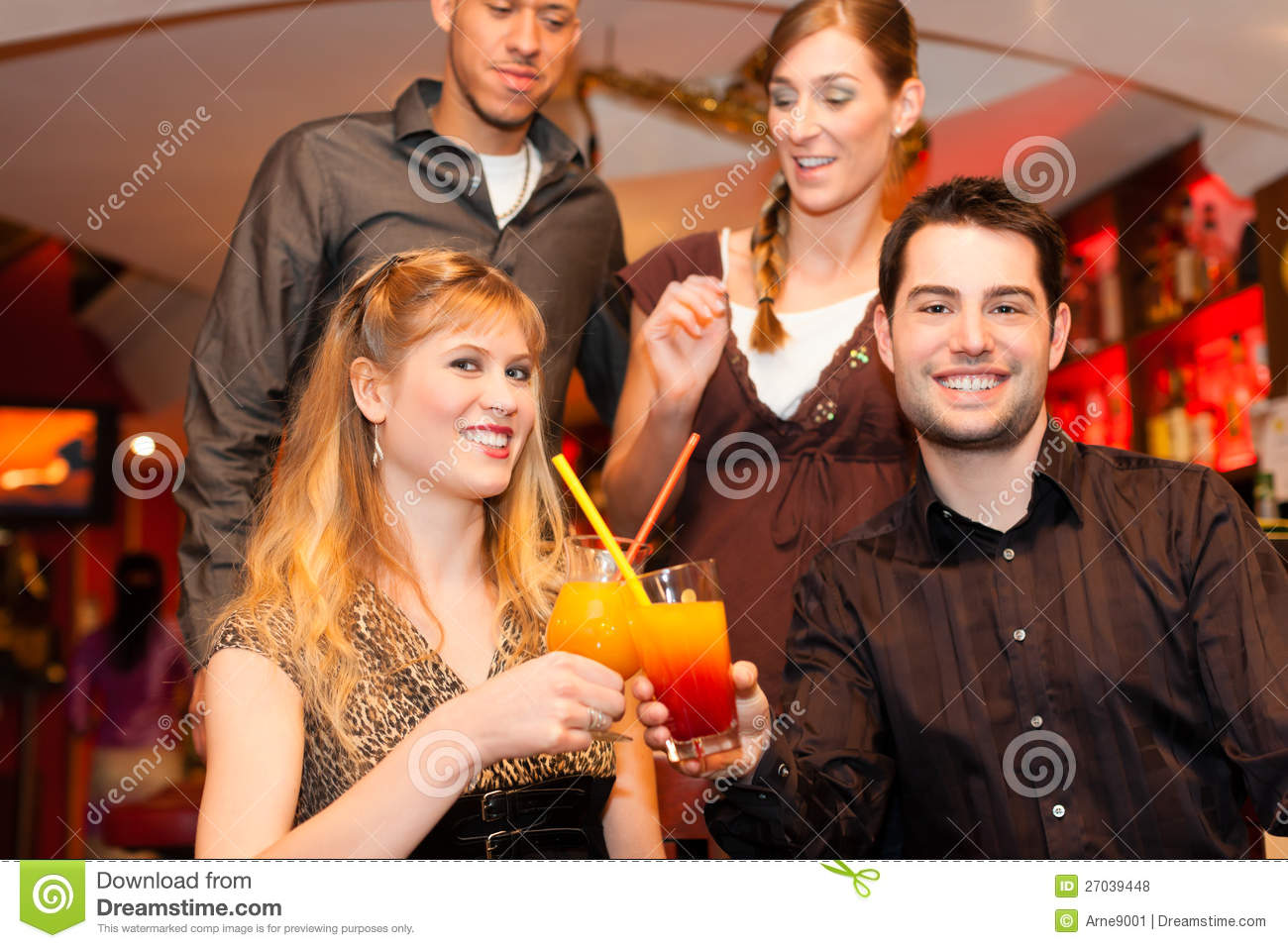 Couples drinking cocktails in bar