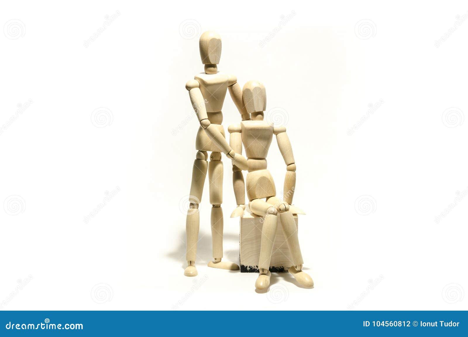 Couples en bois de mannequin et cube en bois