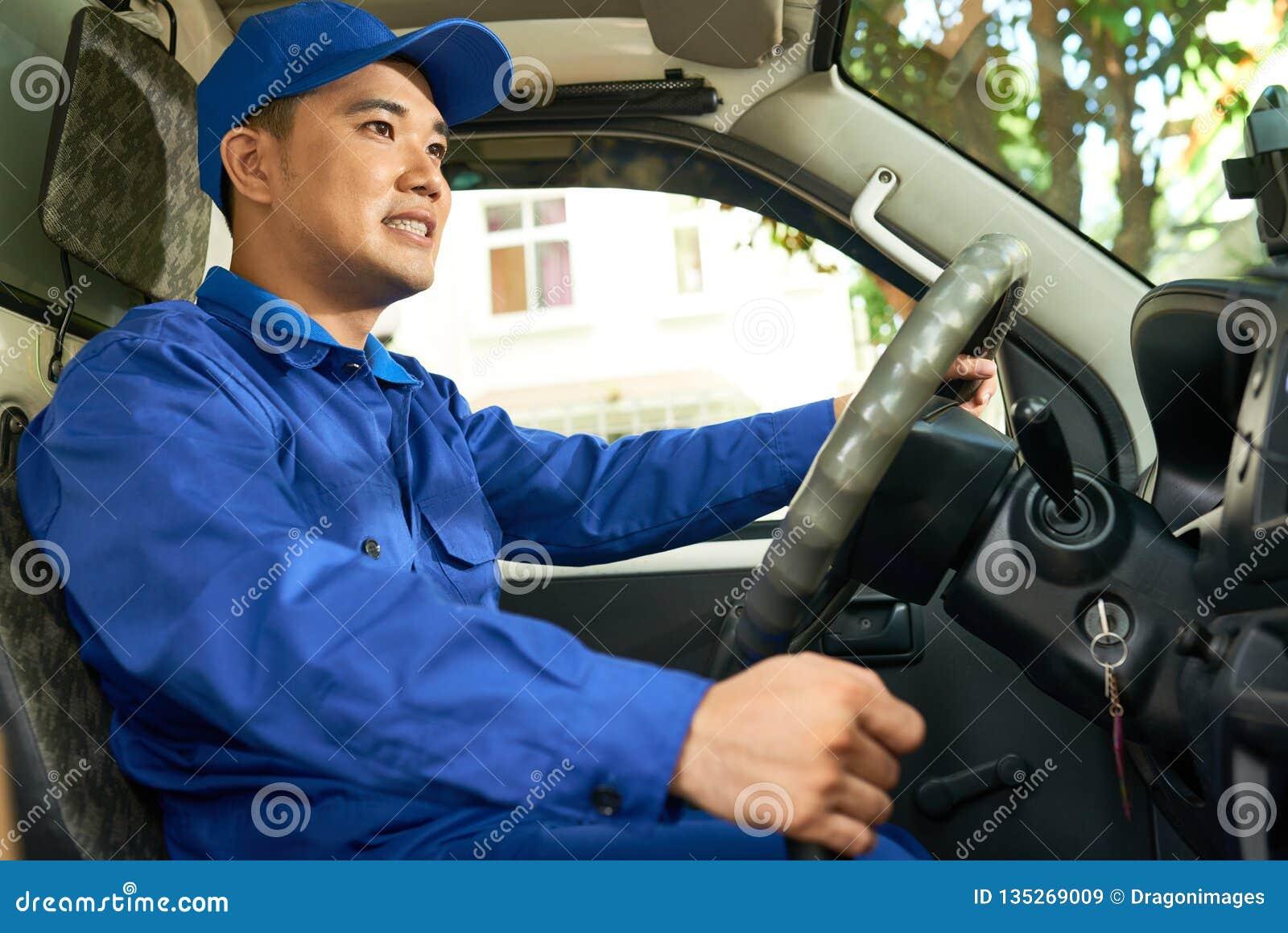 Courier enjoying driving