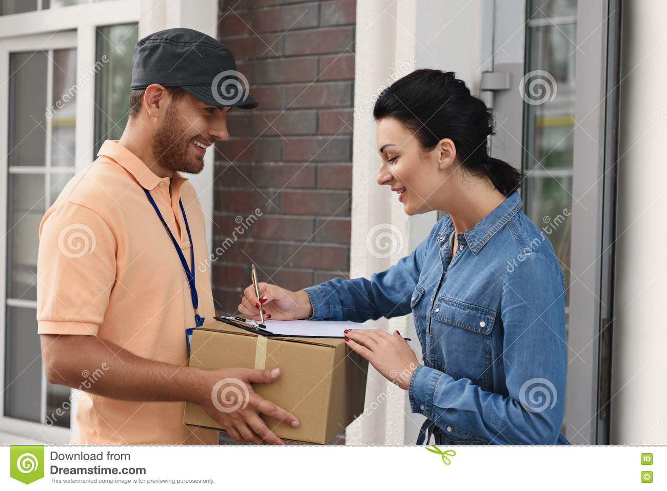 Courier making delivery to beautiful woman