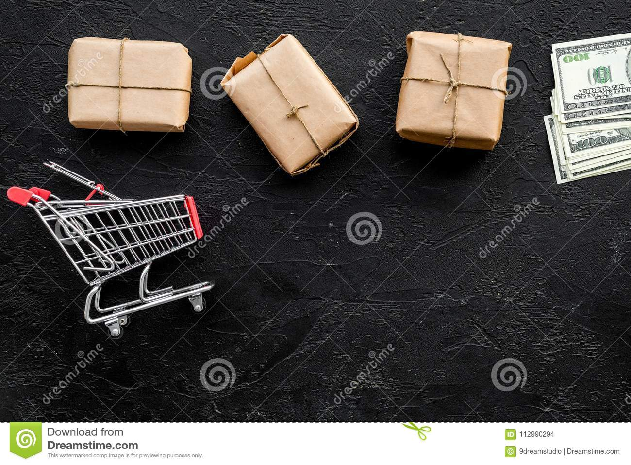Courier workplace with cardboard box and trolley for delivery on black background top view mockup