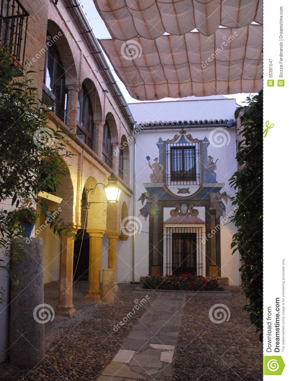 Courtyard covered with towels streetlight lit evening in Cordoba