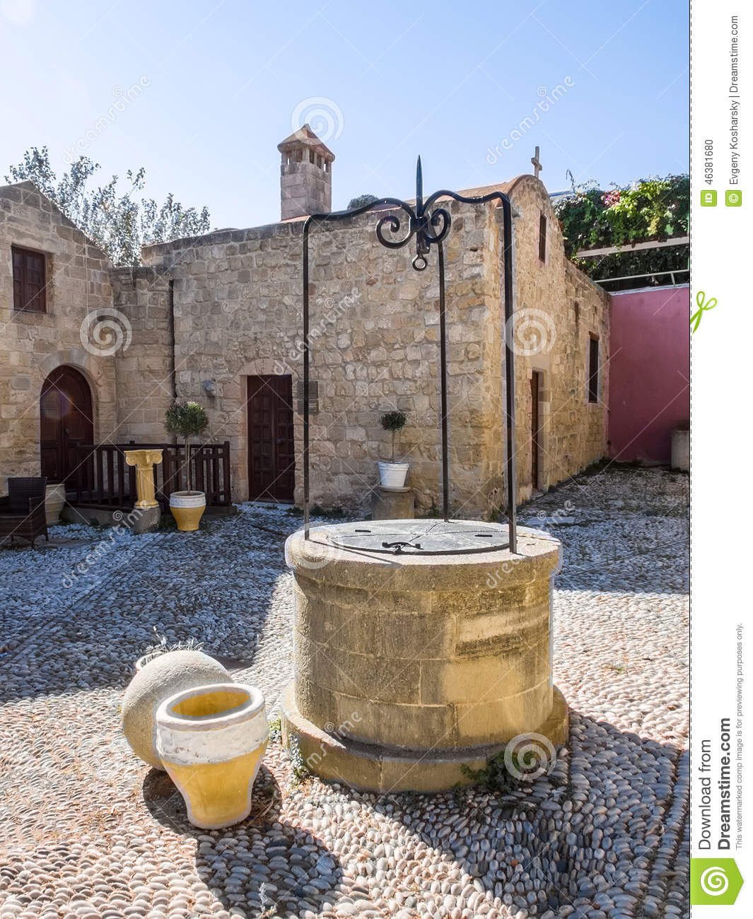 Courtyard And Well At Ancient Church. Rhodes. Greece Stock