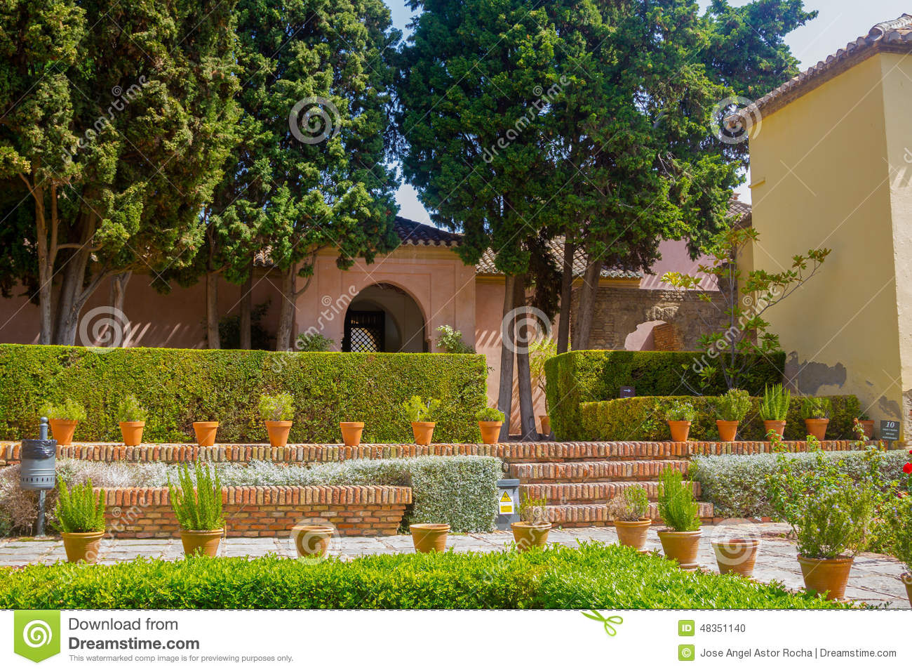 Courtyards And Gardens Of The Famous Palace Of The Alcazaba In M ...