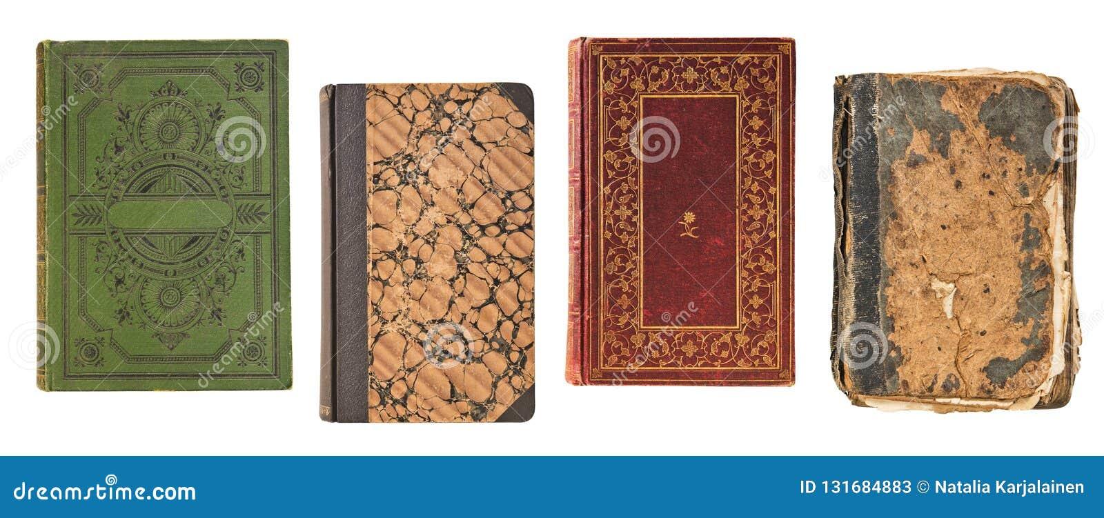 Couverture de livre de quatre livres de cru vieux d isolement sur le fond blanc