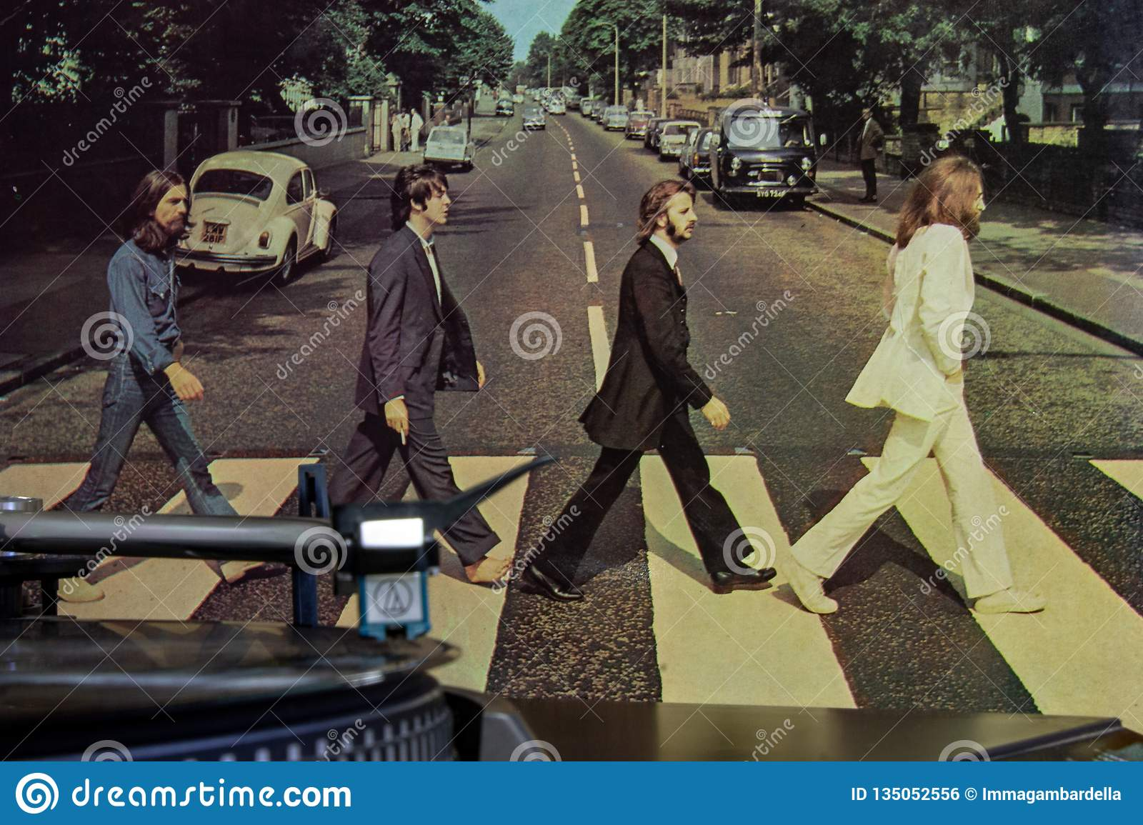 Cover of the famous Beatles Abbey Road album with a turntable in the foreground.