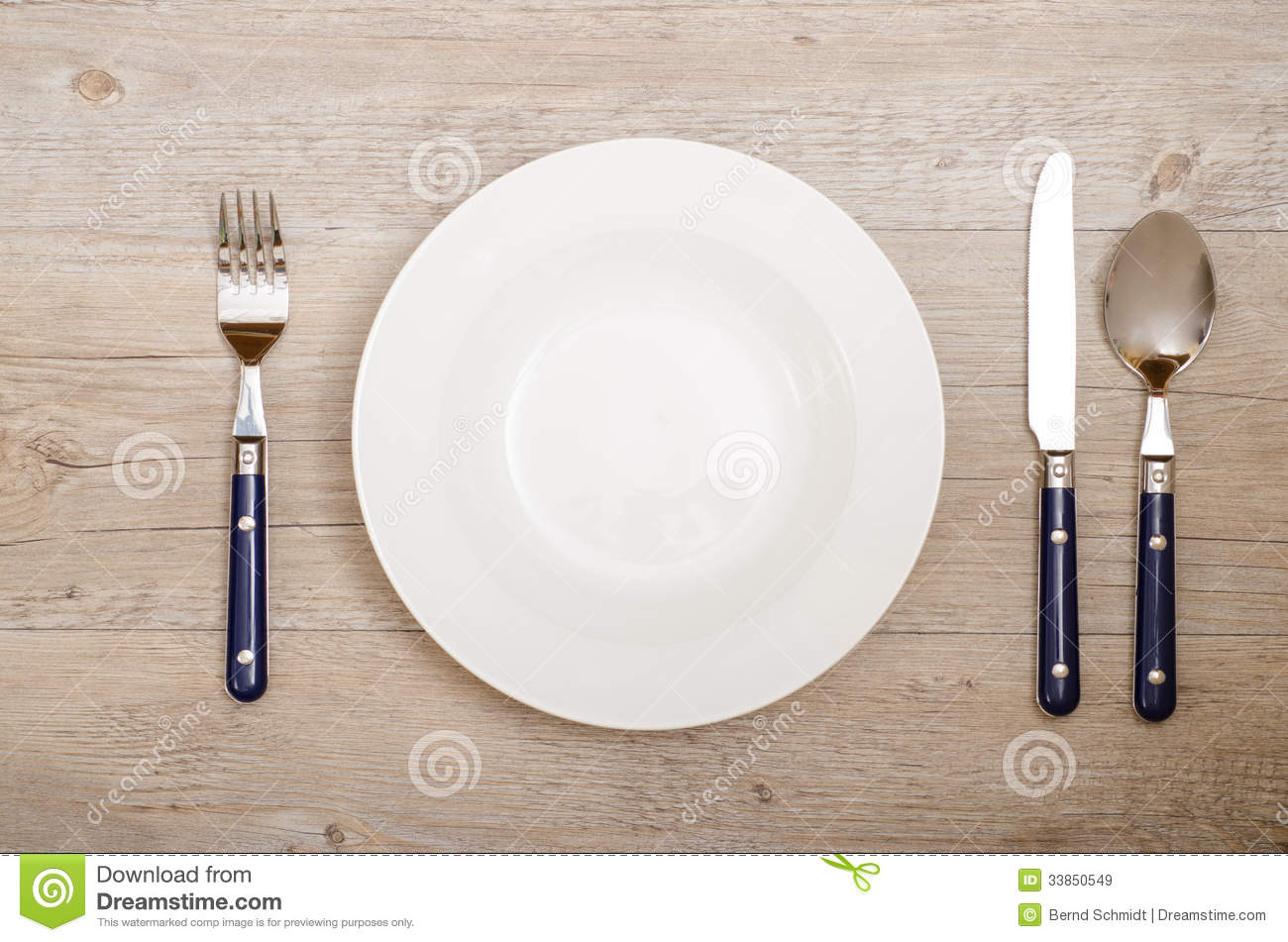 Cover with knife fork and spoon on a dining table stock for On the table restaurant