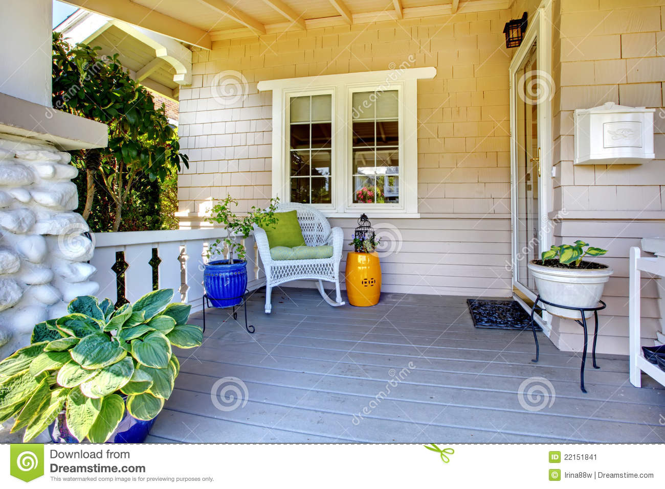 Covered Entrance Porch With Plants And Chair Stock Image