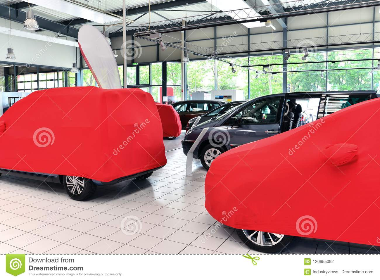 Covered New Cars In The Sales Area Of A Car Dealership Stock Photo