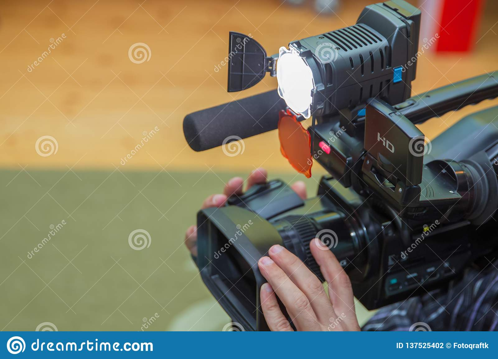 Covering an event with a video camera., Videographer takes video camera with free copy space for text., Video camera operator