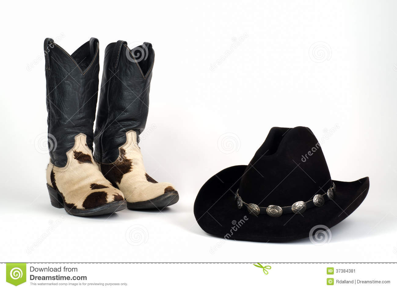 Cow Hide Cowboy Boots And Black Hat With Conchos. Stock Image ... 5637a9a7cfa1