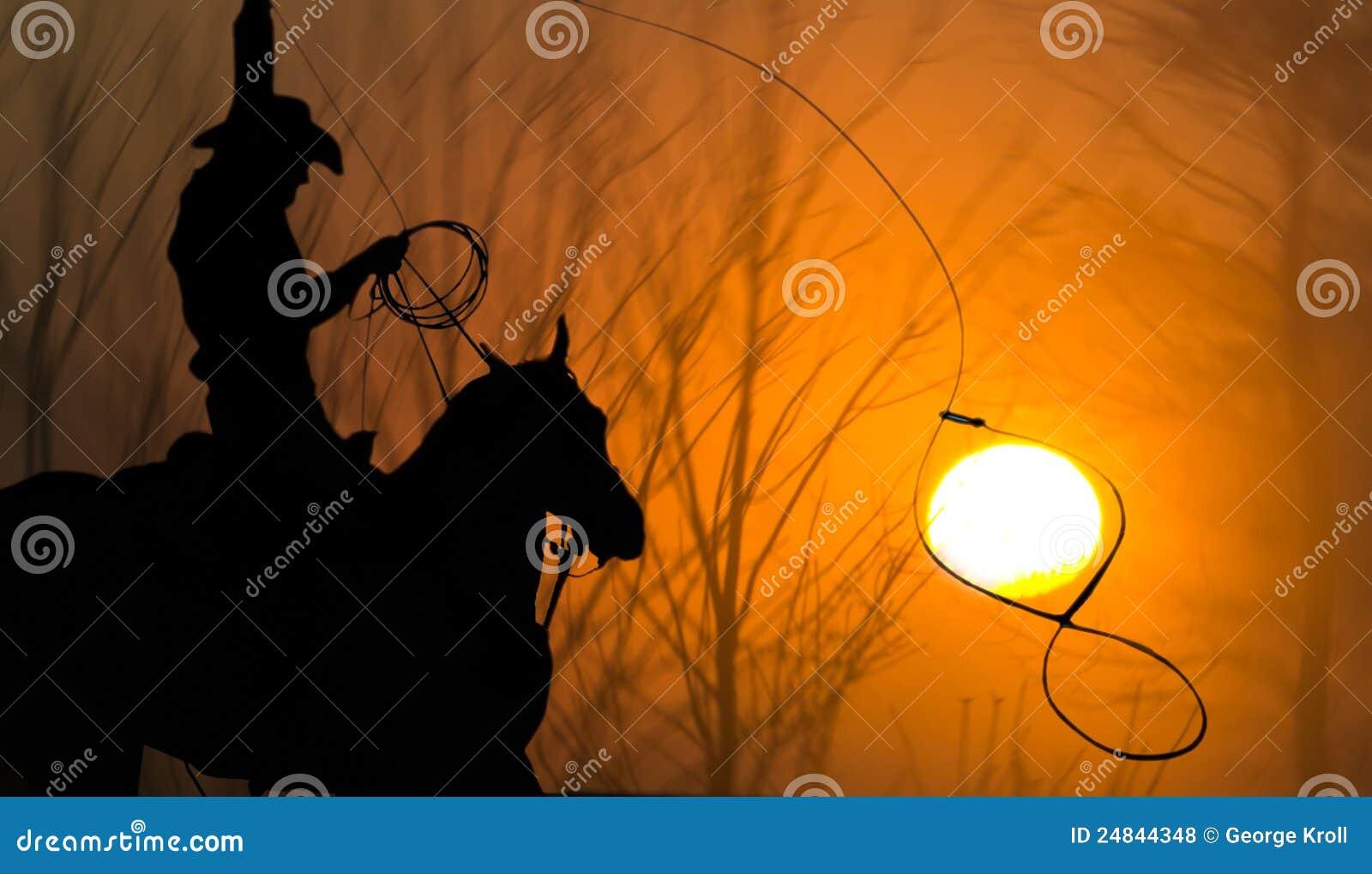 Cowboy auf dem Pferd Lasso, der Sun Roping ist