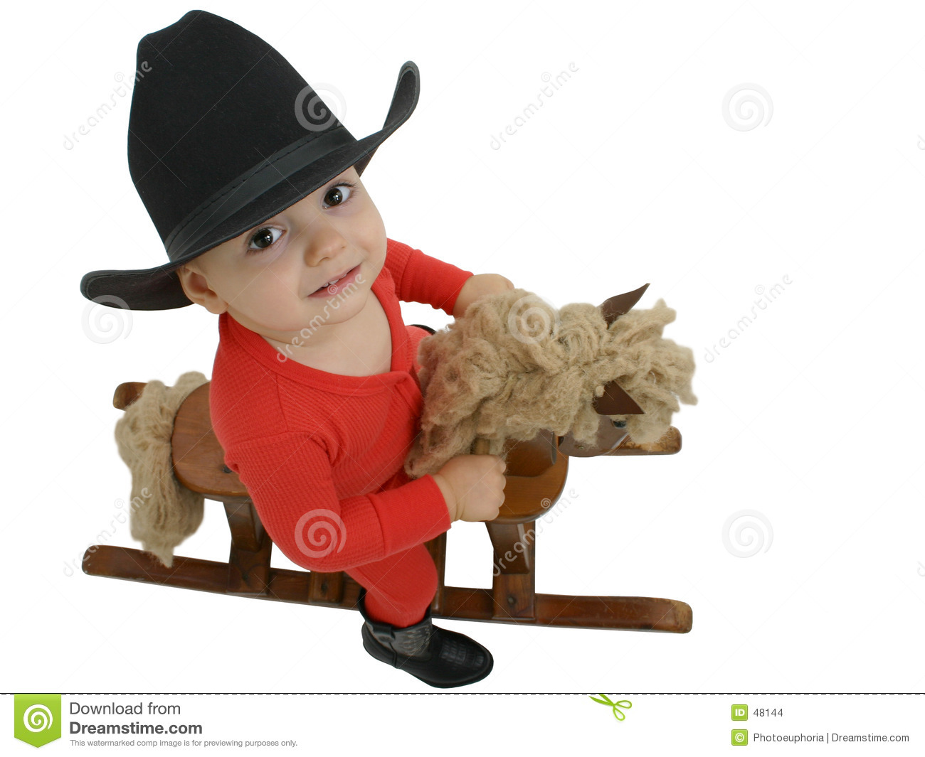 Cowboy Baby with Black Hat on a Rocking Horse