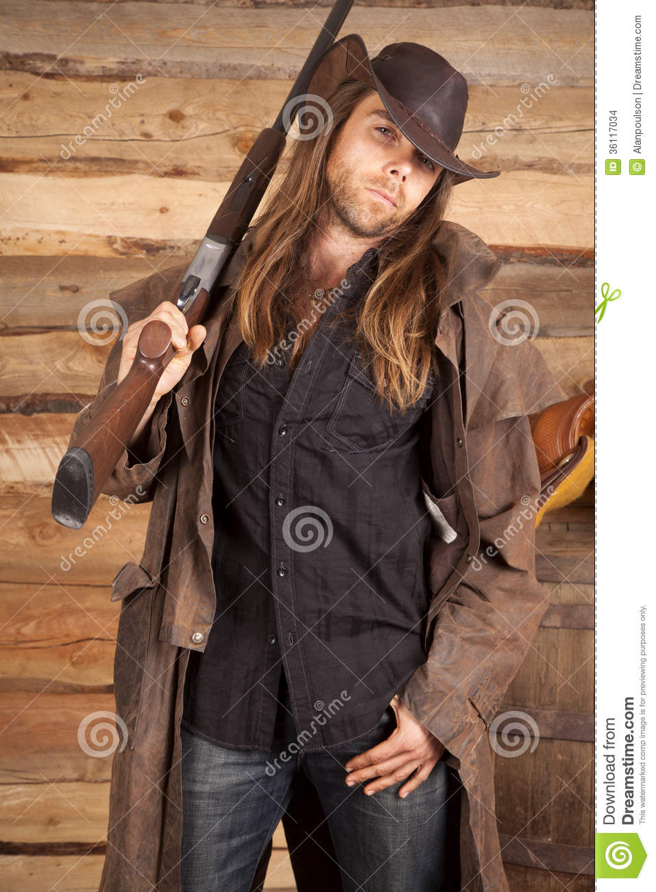 d159b9bb3b6e3 Cowboy Duster Long Hair Rifle On Shoulder Look Stock Photo - Image ...