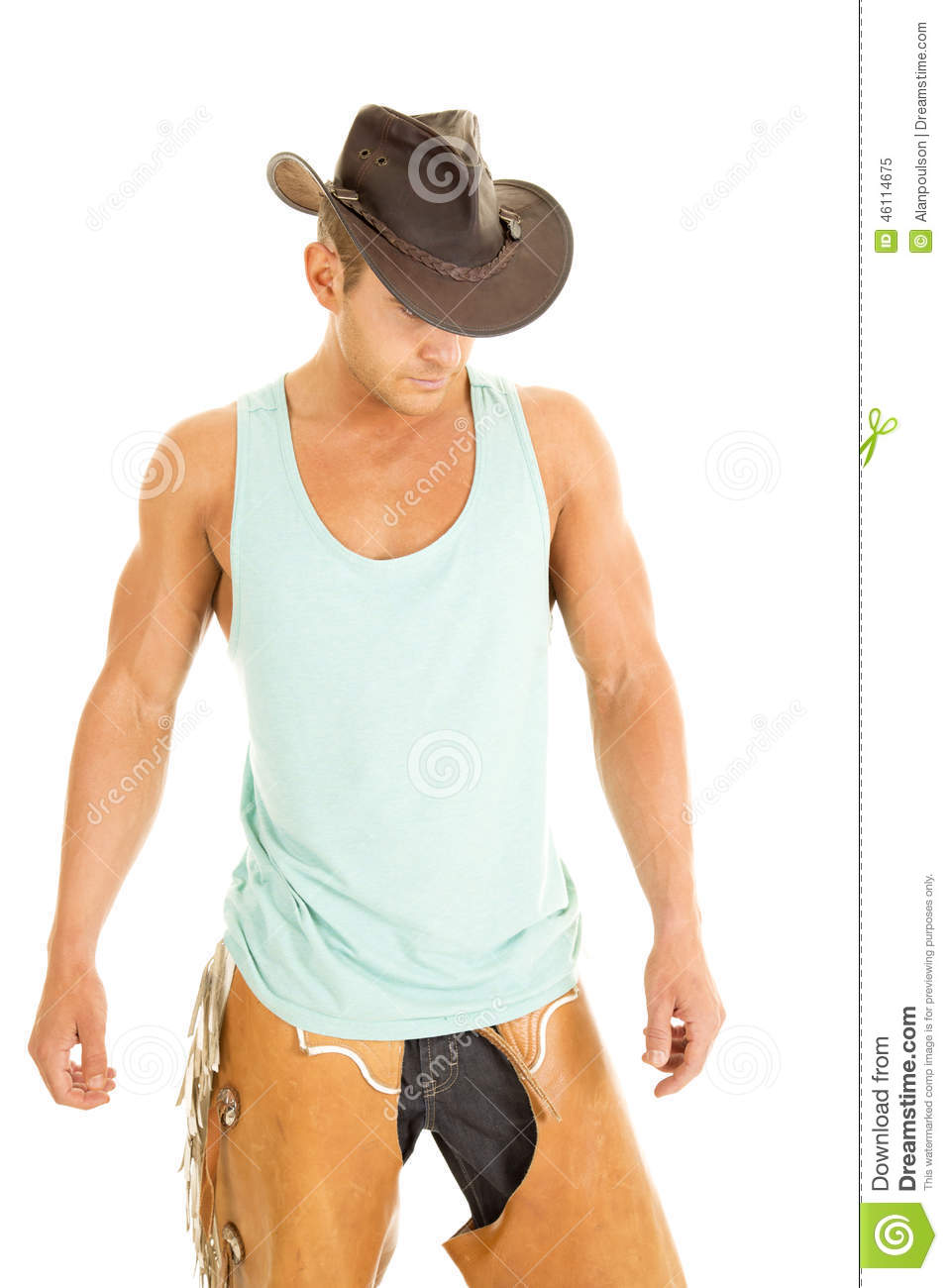 A cowboy in his green tank and chaps wearing his hat