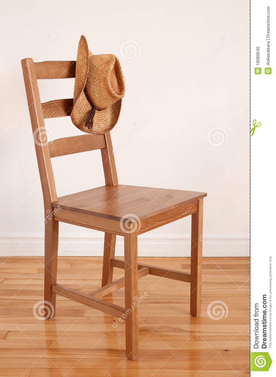 Cowboy Hat On A Wooden Chair Stock Photo