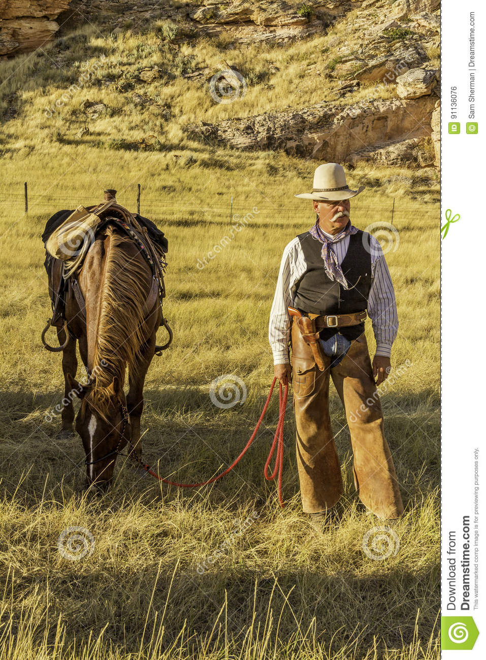 Cowboy by his Horse.