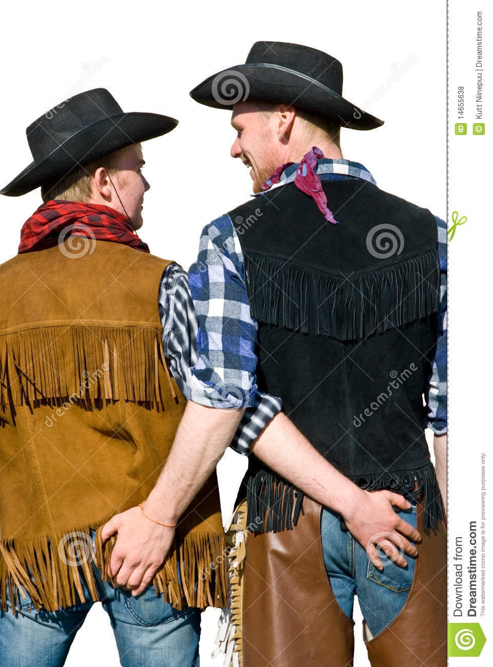 Two Men In Cowboy Costumes Caressing Each Other