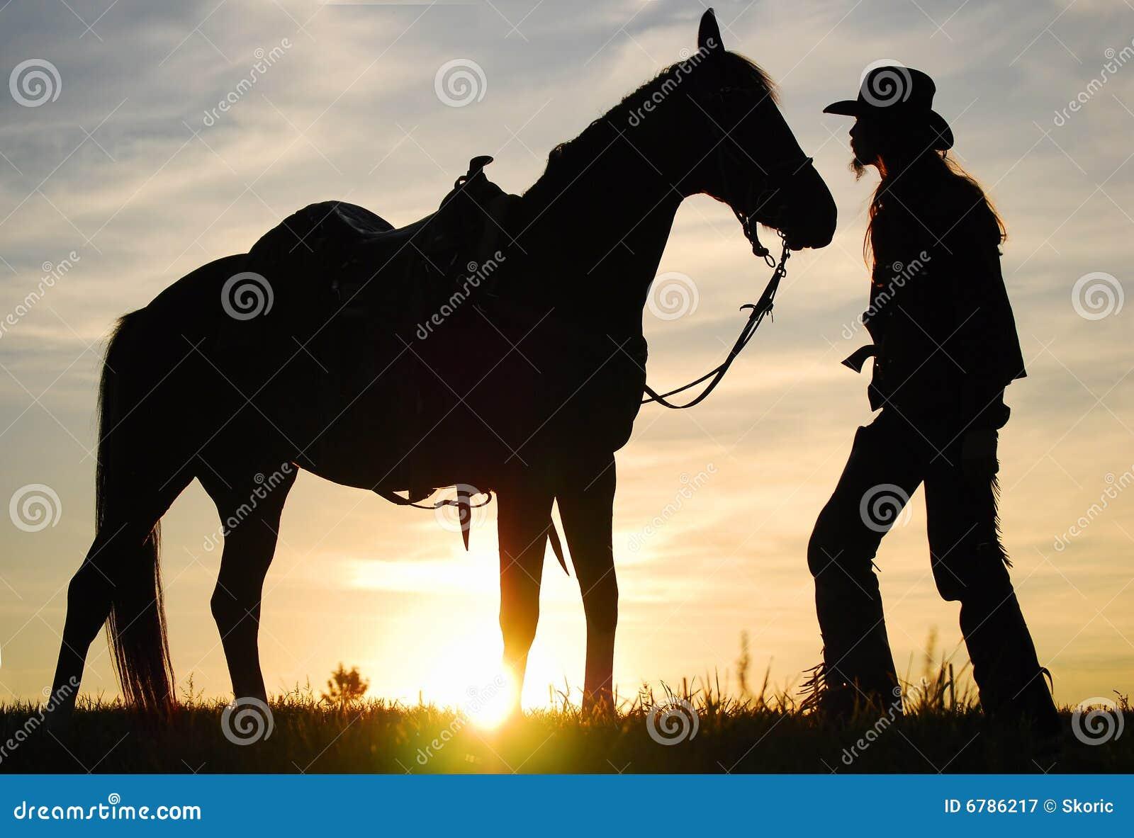 Cowboy mit seinem Pferd