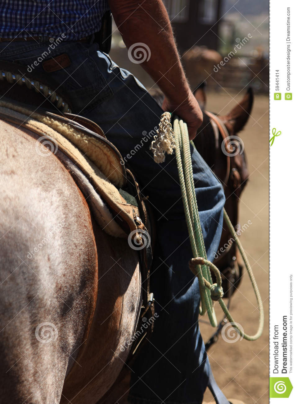 Download A cowboy riding a horse. stock photo. Image of nature - 59441414