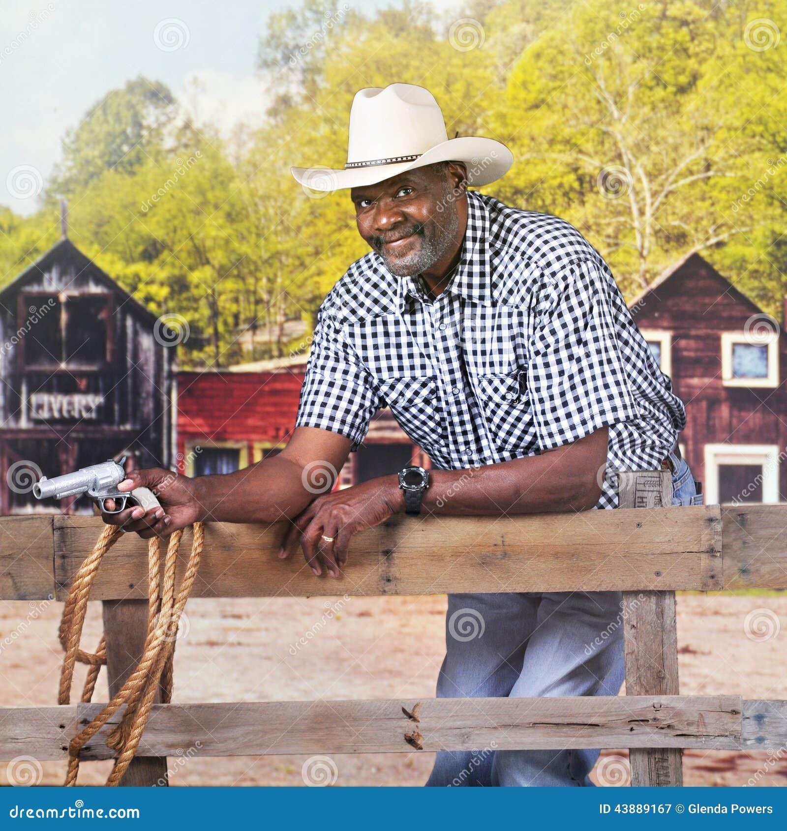 Cowboy's Got A Gun Stock Photo