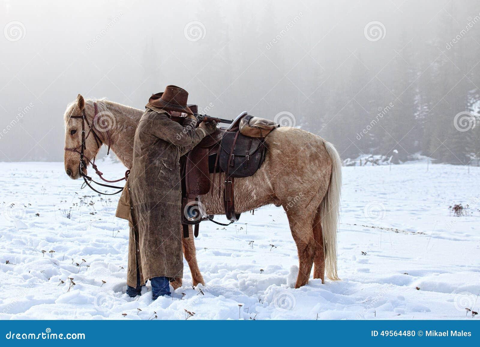 Cowboy shooting across his saddle