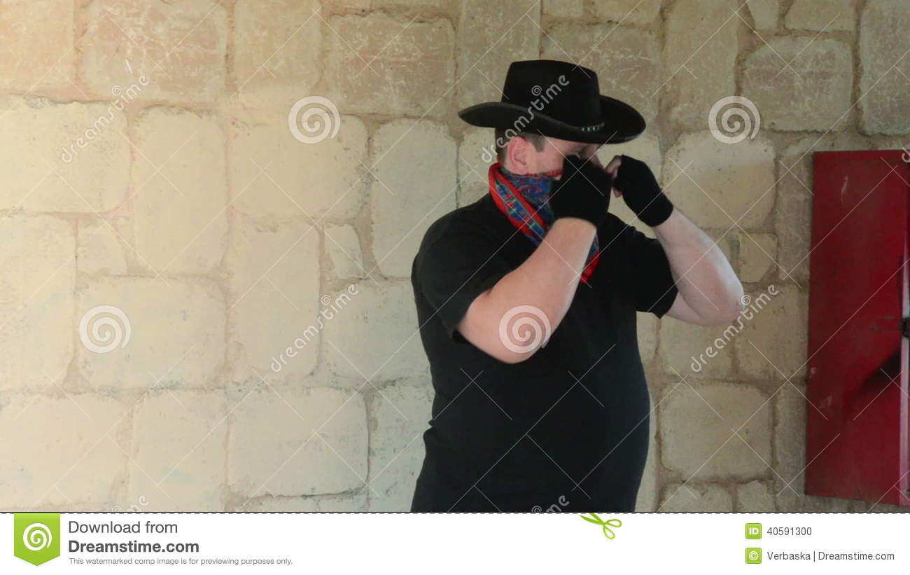 Cowboy Wearing Bandana Scarf On His Face Stock Footage