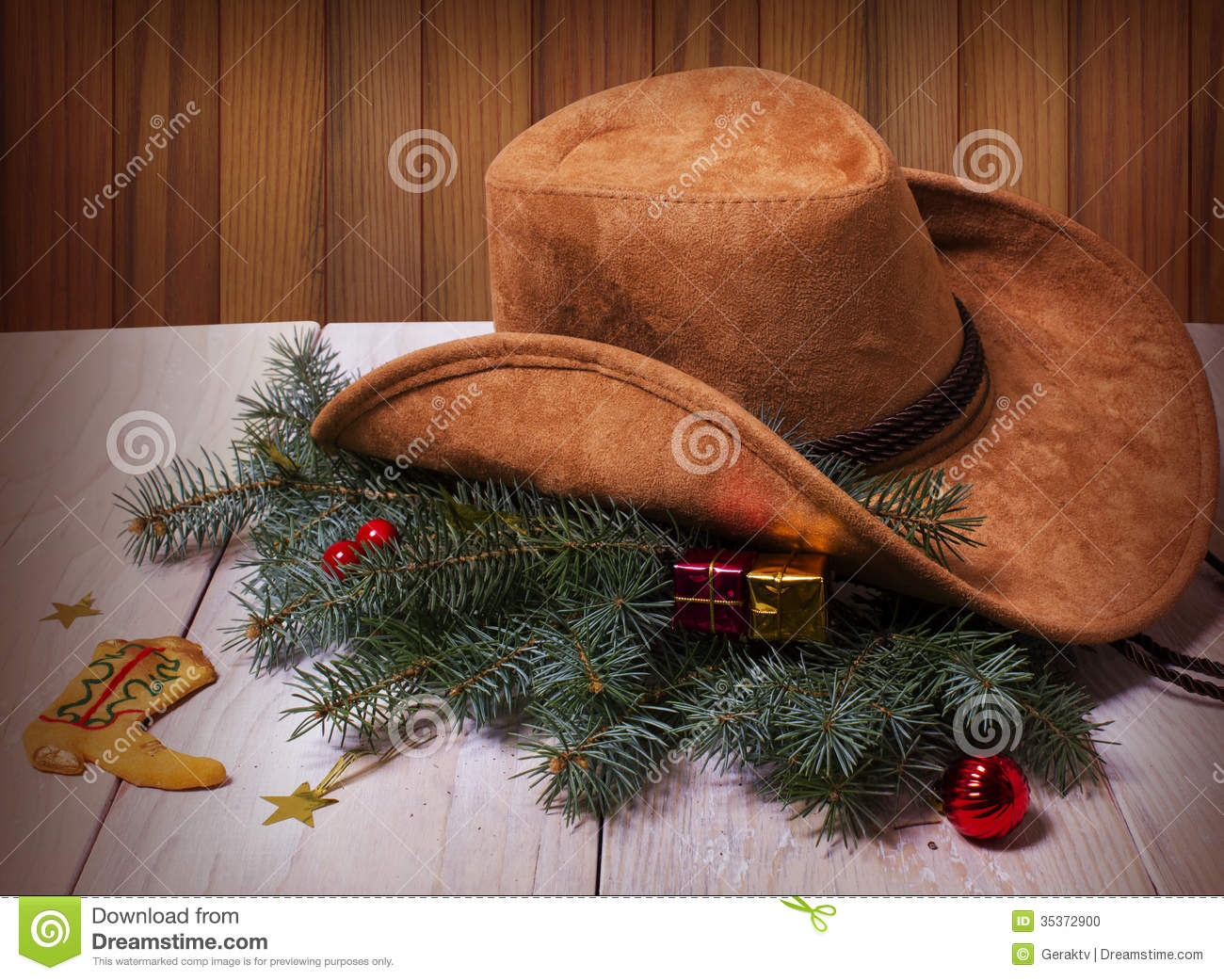 cowboy western hat and christmas decoration on wood background - Western Christmas Decorations
