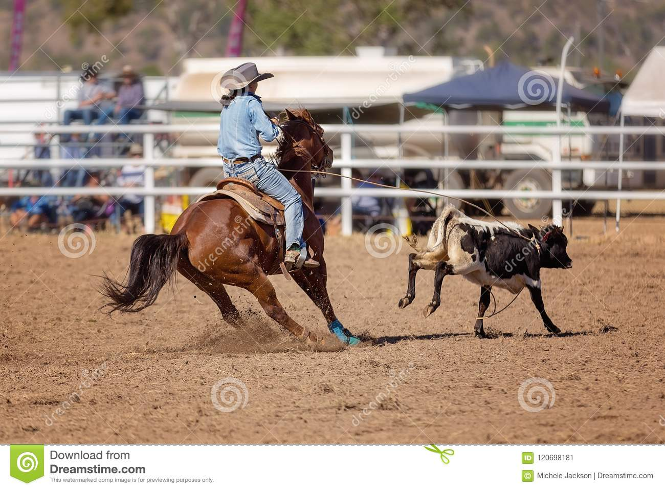 f2b631662aaa7 Cowgirl Competing In A Calf Roping Event At A Country Rodeo ...