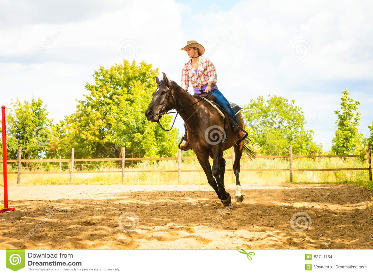 Cowgirl Doing Horse Riding On Countryside Meadow Stock Photo