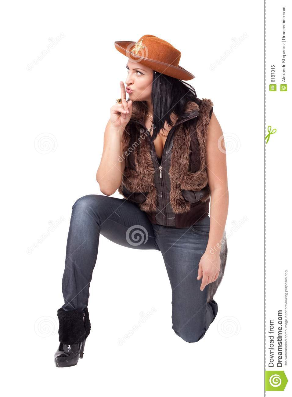 Cowgirl in jeans, boots and cowboy hat sitting against isolated white ...