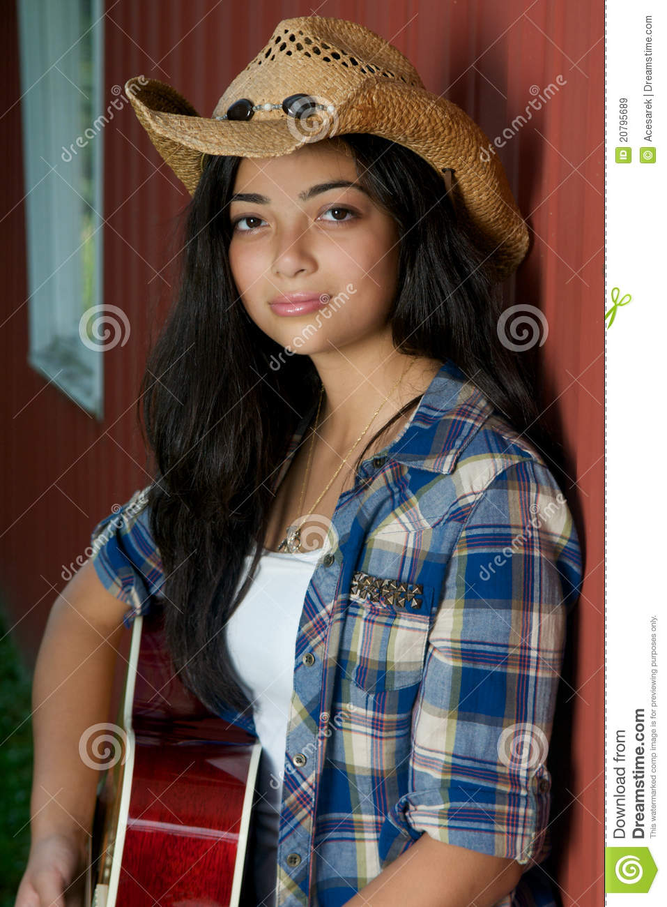 Cowgirl Playing Guitar By The Barn Royalty Free Stock