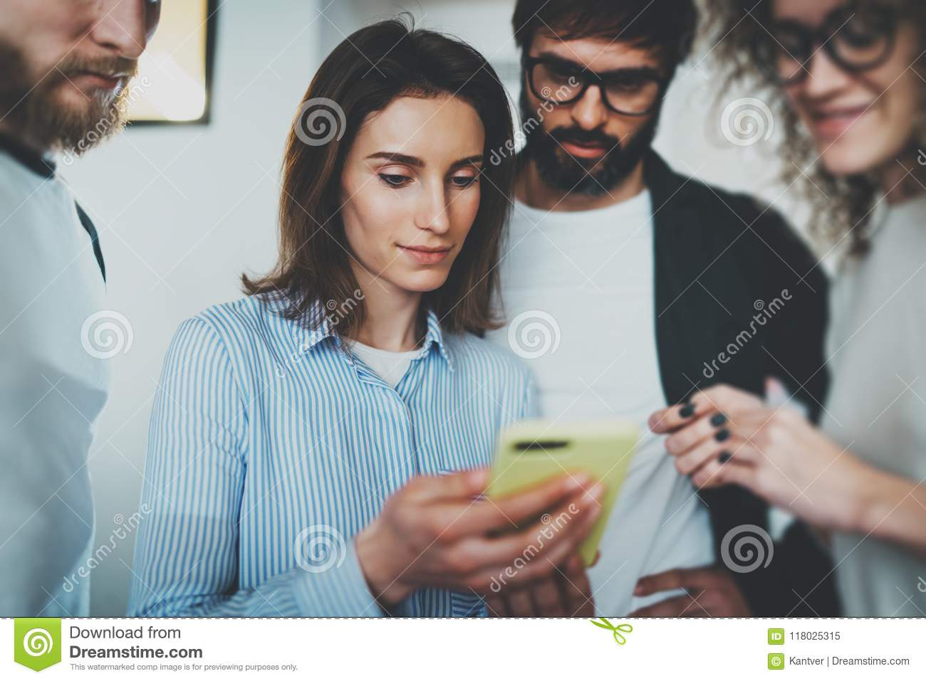 Coworkers business meeting concept.Young women holding mobile smartphone hand and showing information to her colleagues