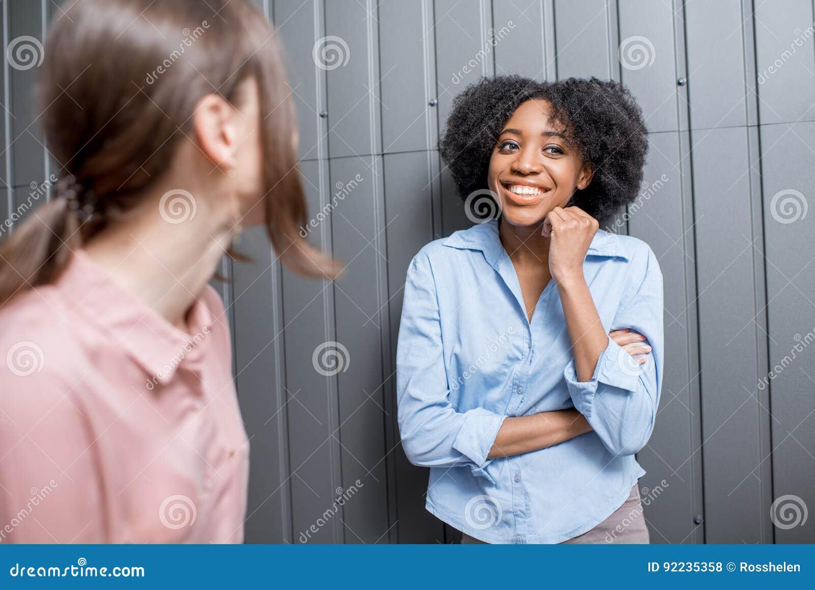 Coworkers talking indoors