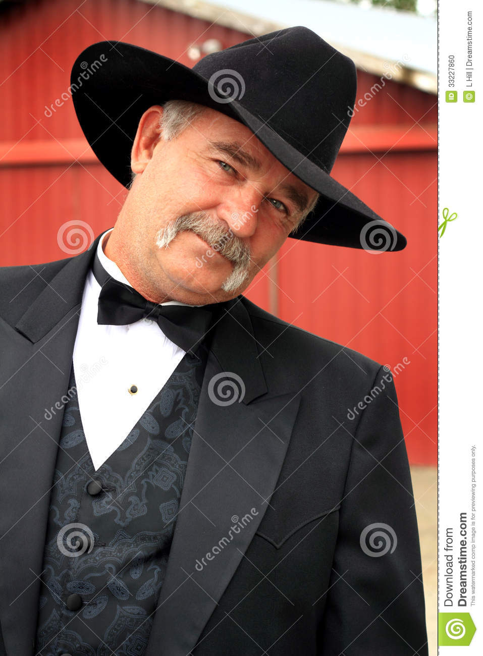 coy middle aged American rancher with a full mustache wearing formal ...