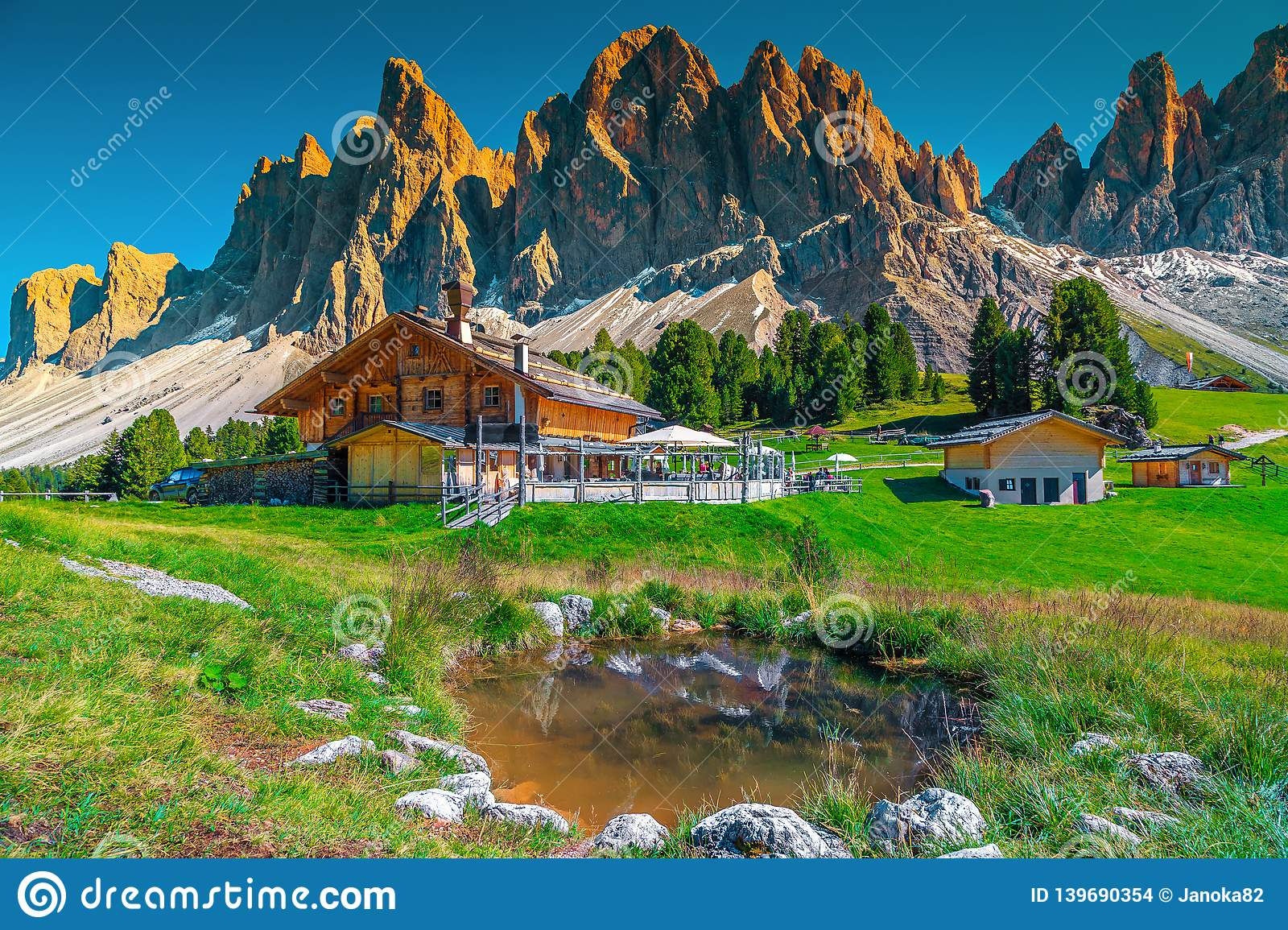 Cozy alpine chalets with mountain lake in Dolomites, Italy, Europe