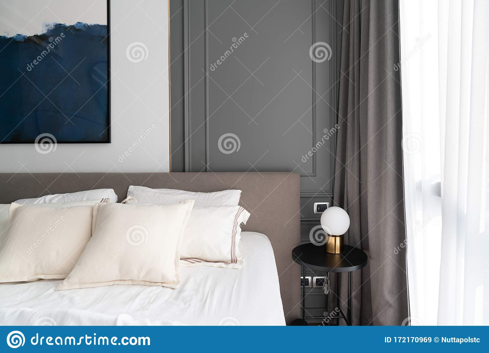 Cozy Bedroom Corner With Modern Brown Fabric Bed Headboard And Comfortable Pillows Setting With Gold Lamp And Modern Plug Install Stock Image Image Of Background Decor 172170969